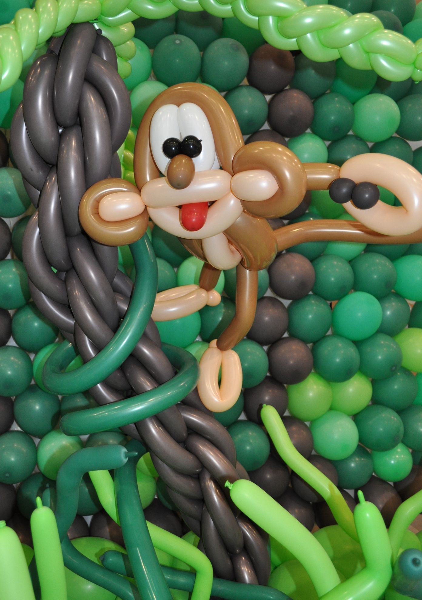 Balloon monkey throwing balloon poop
