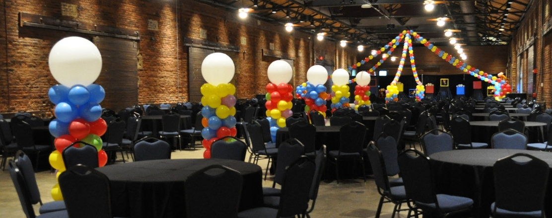 Circus-themed prom balloon columns and dance floor