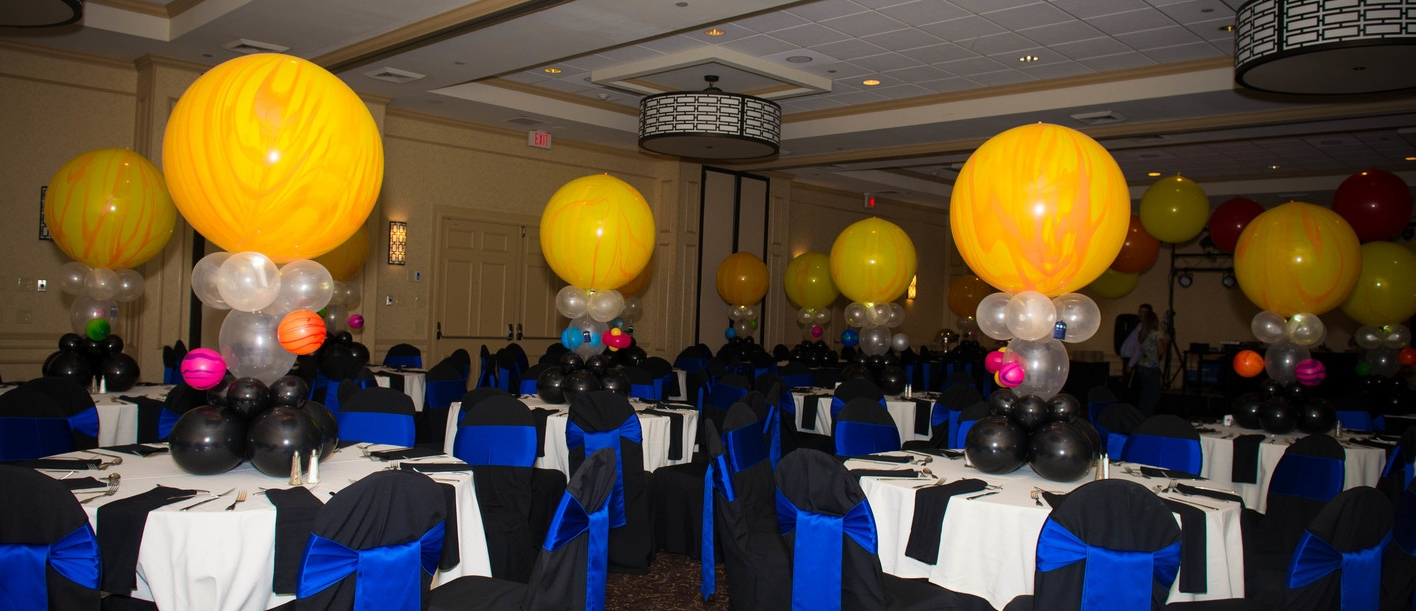 Doctor Who Bar Mitzvah balloon centerpieces - each sun with different planets