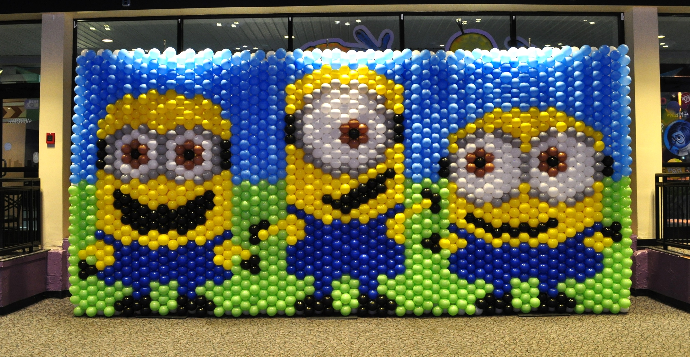 Minions movie premier at Aurora Cineplex balloon mural