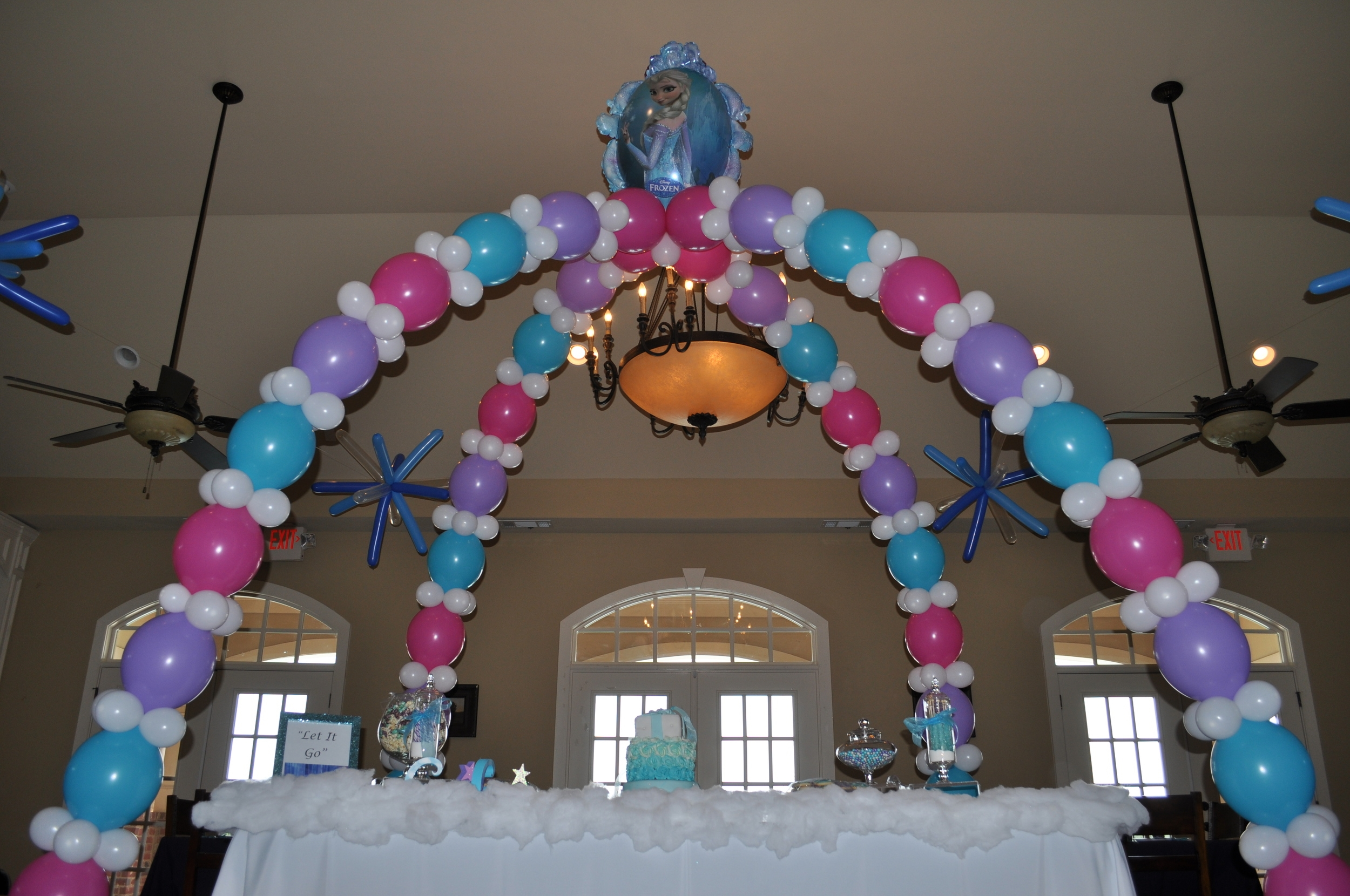 Frozen themed birthday party balloon cake table