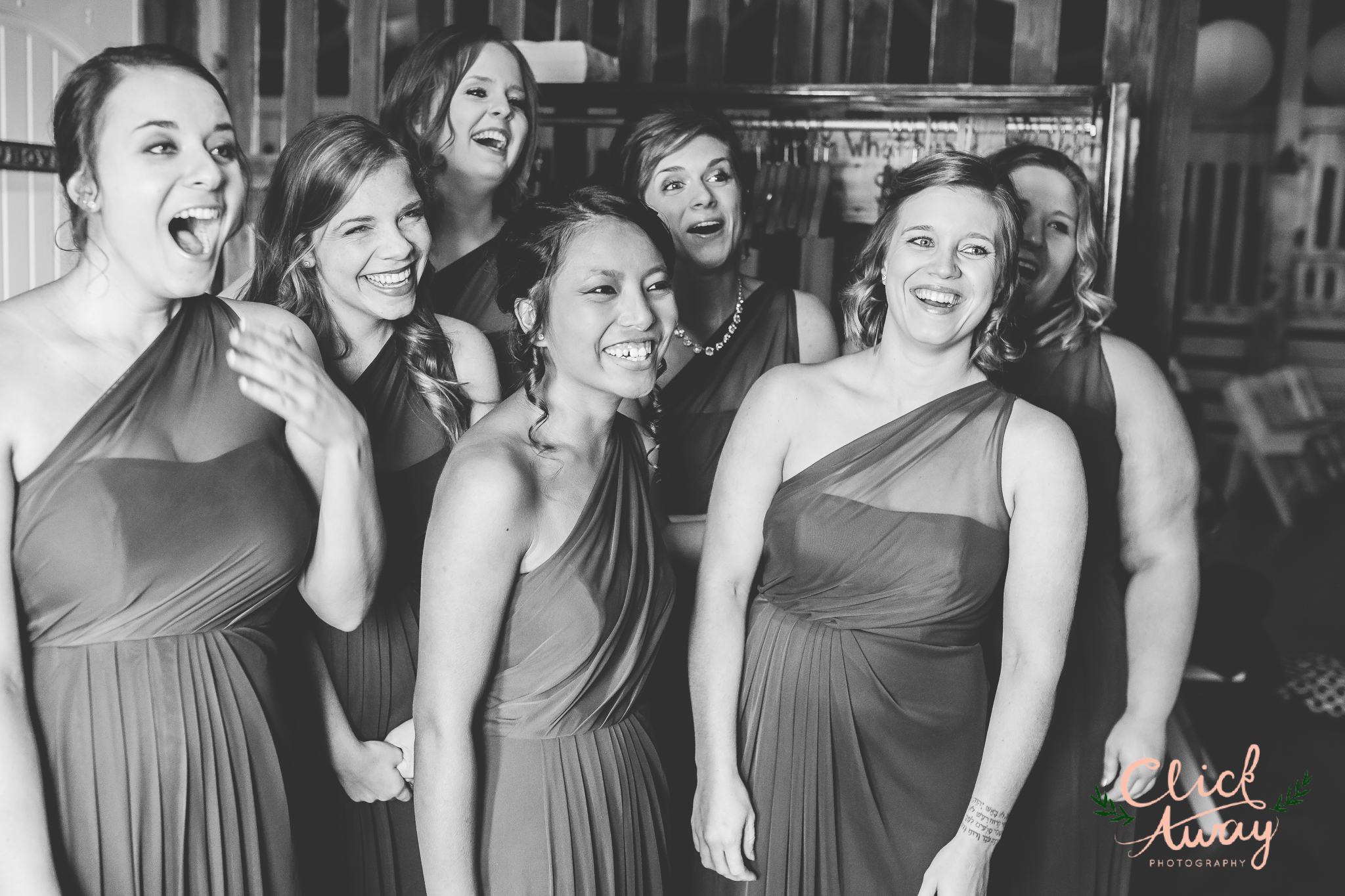 bridesmaids reacting to bride's dress in black and white