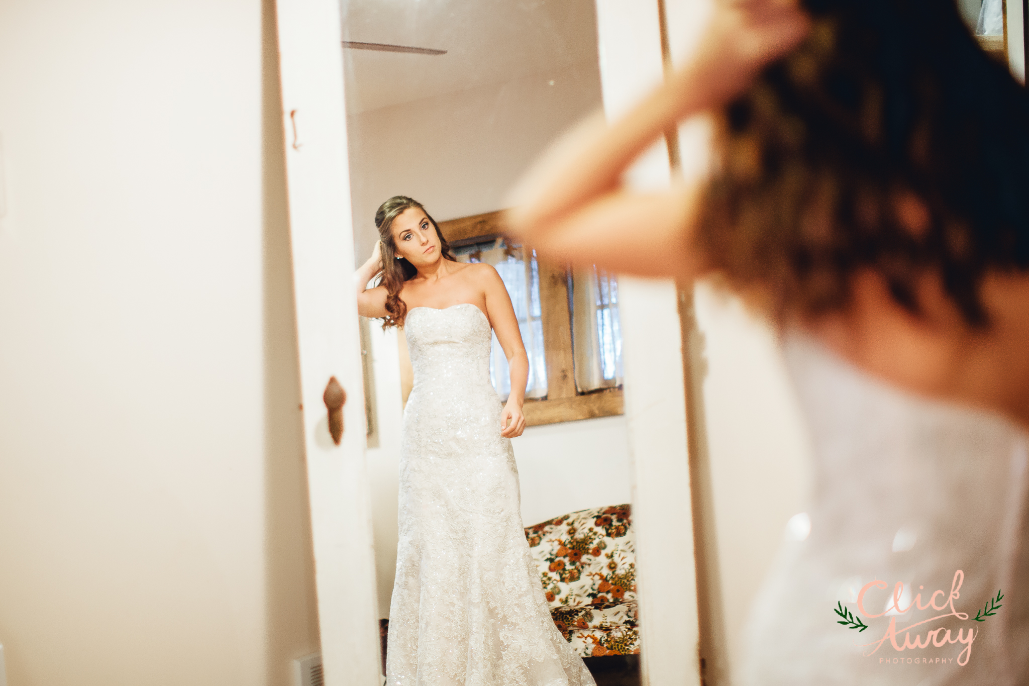 bride looking at herself on mirror pose