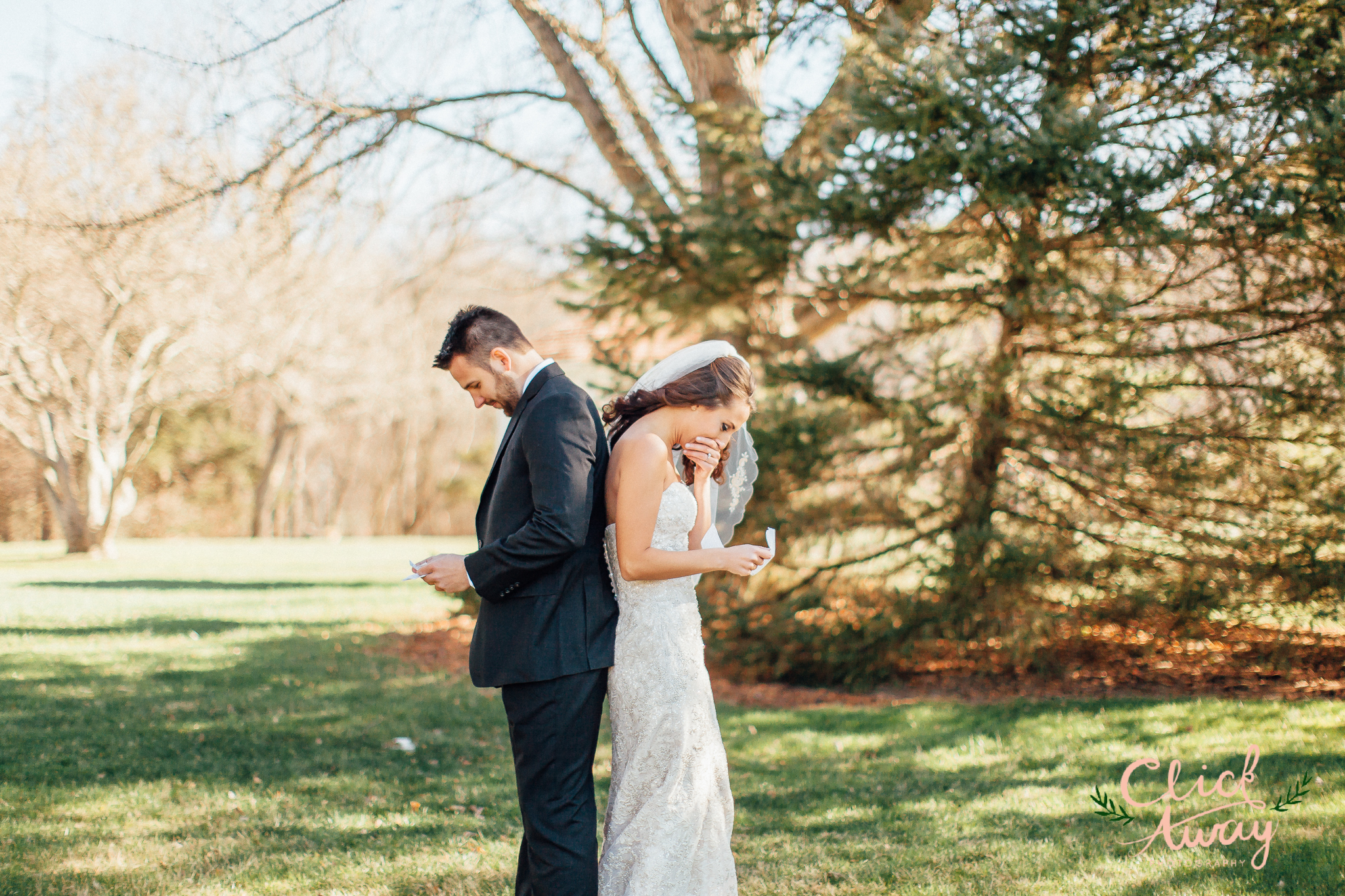 bride and groom reading personal vows