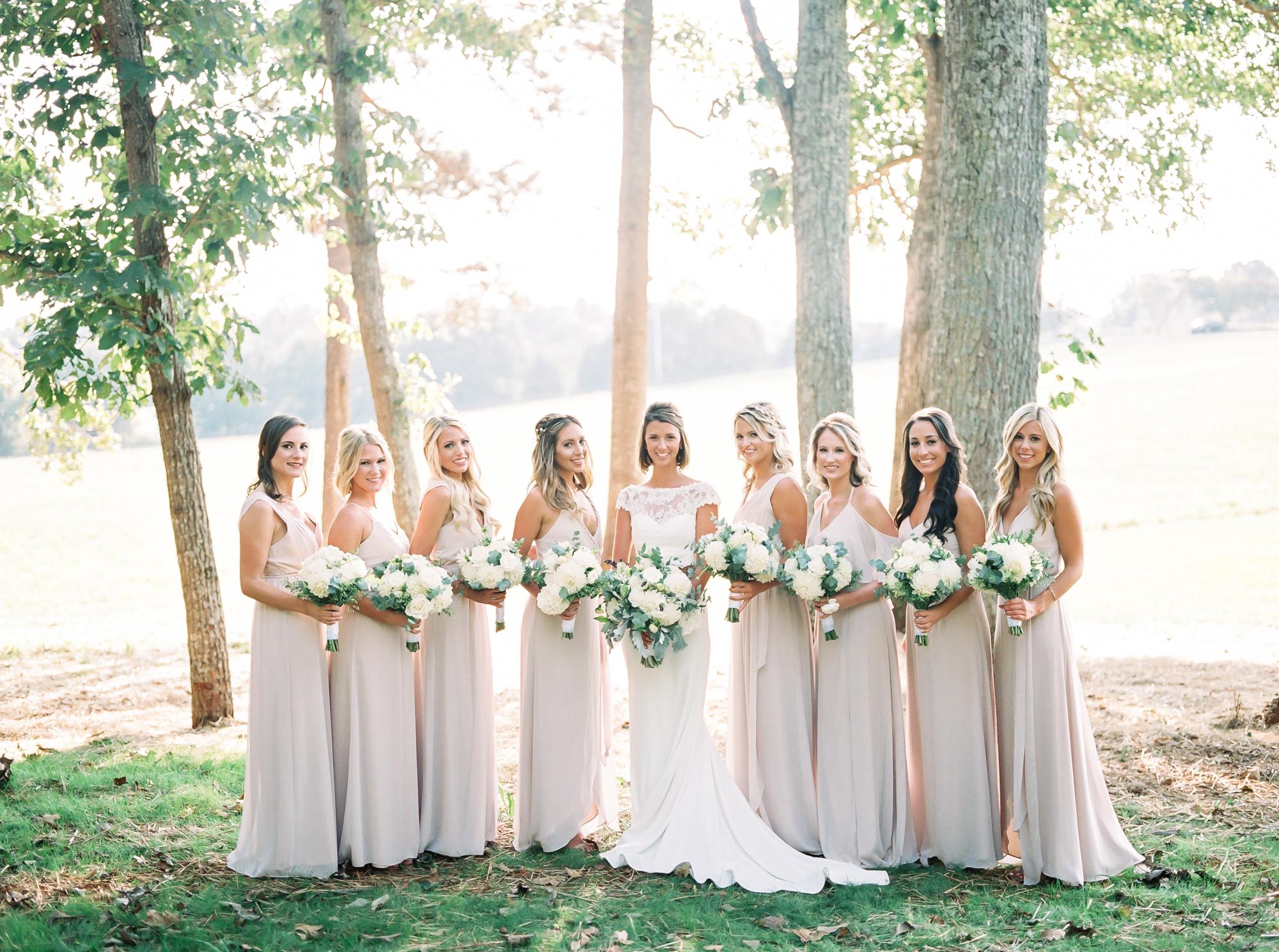 bride with bridesmaids in farmhouse wedding