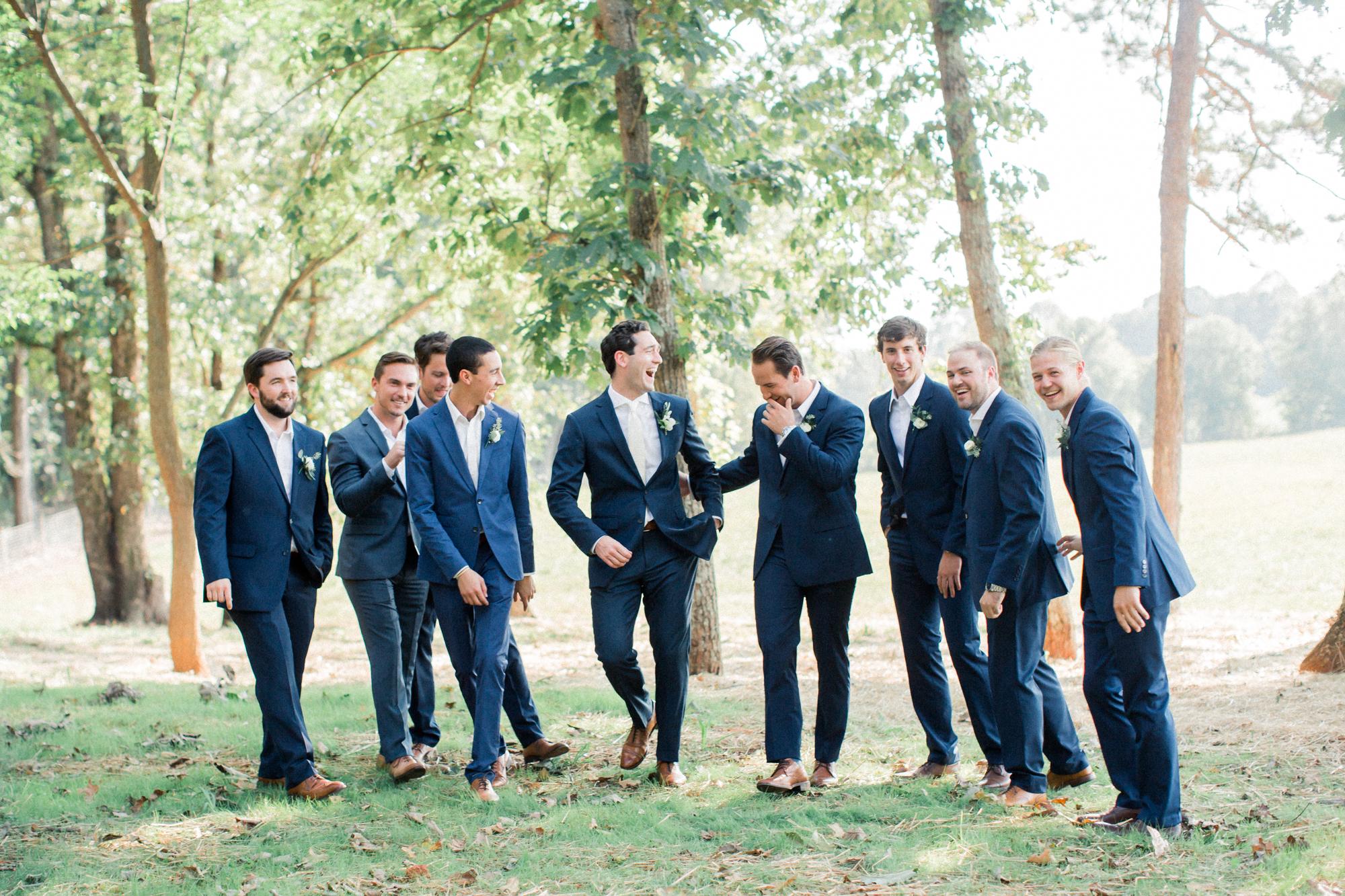 Groom interacting with groomsmen