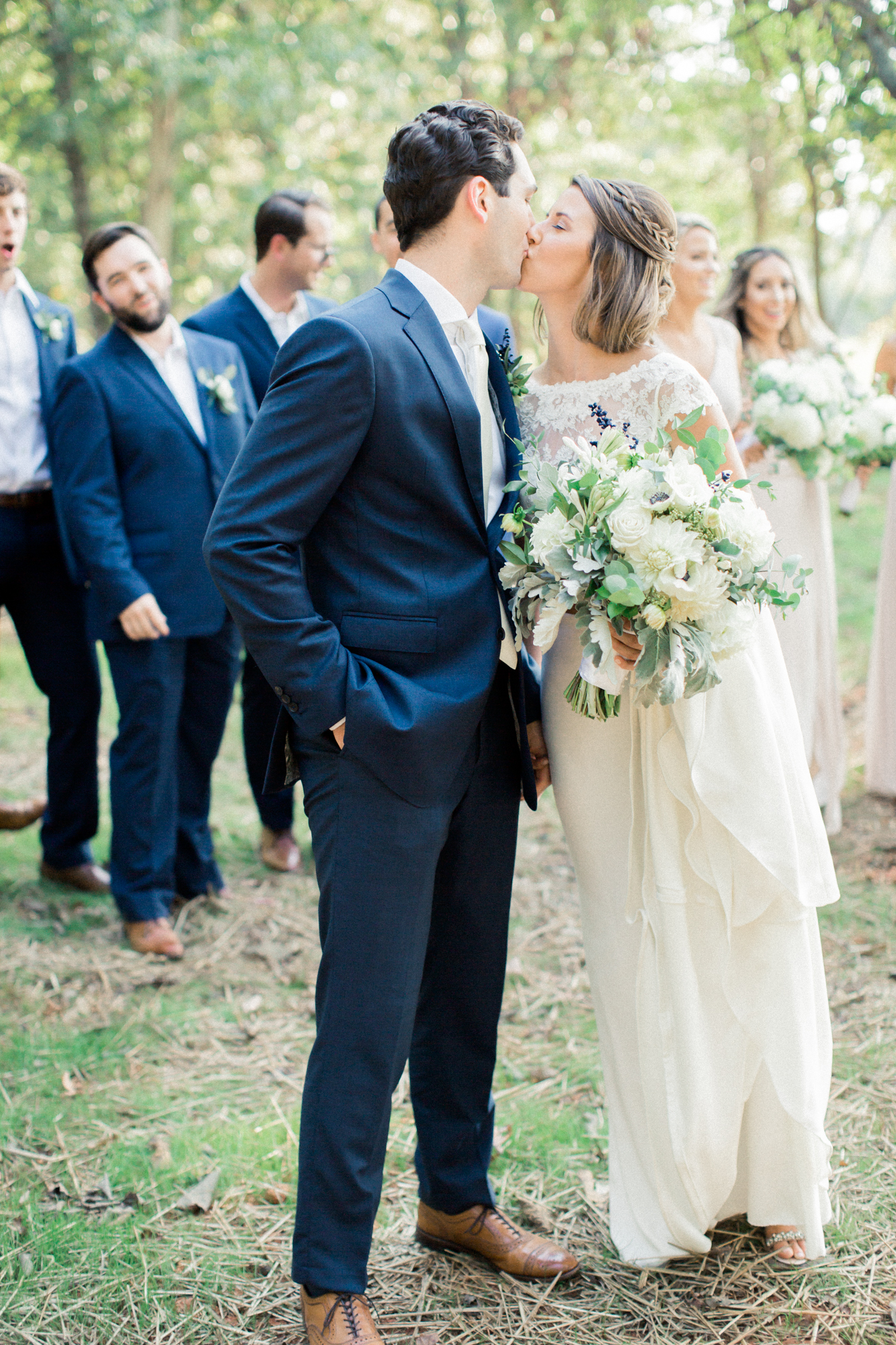 bride and groom kissing in farmhouse wedding