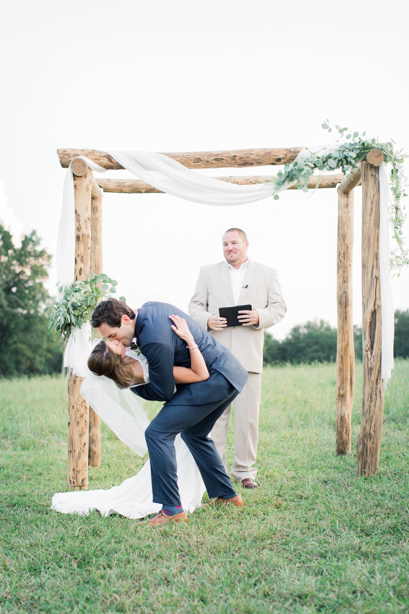 farmhouse wedding first kiss