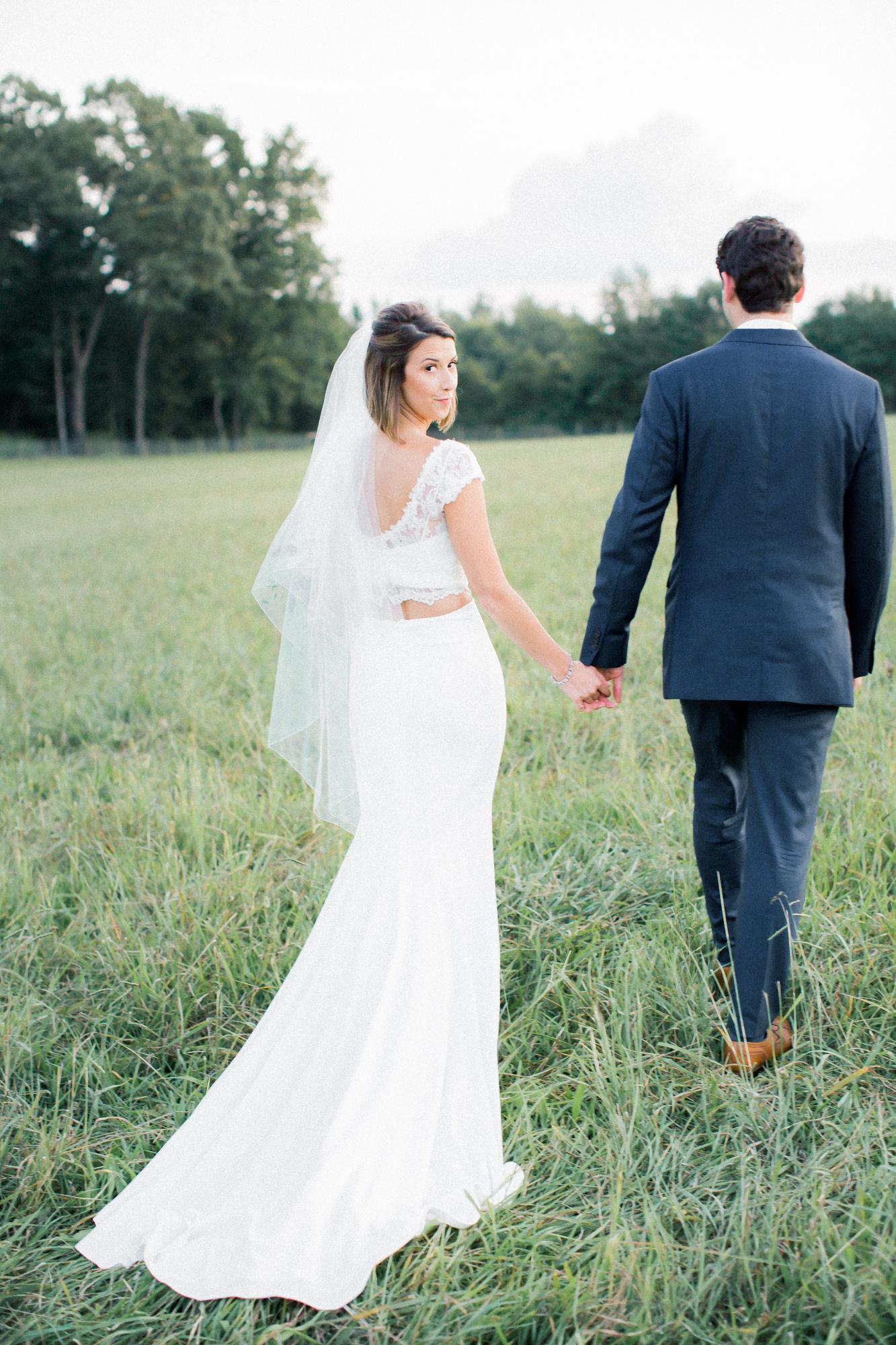 groom leading bride portrait