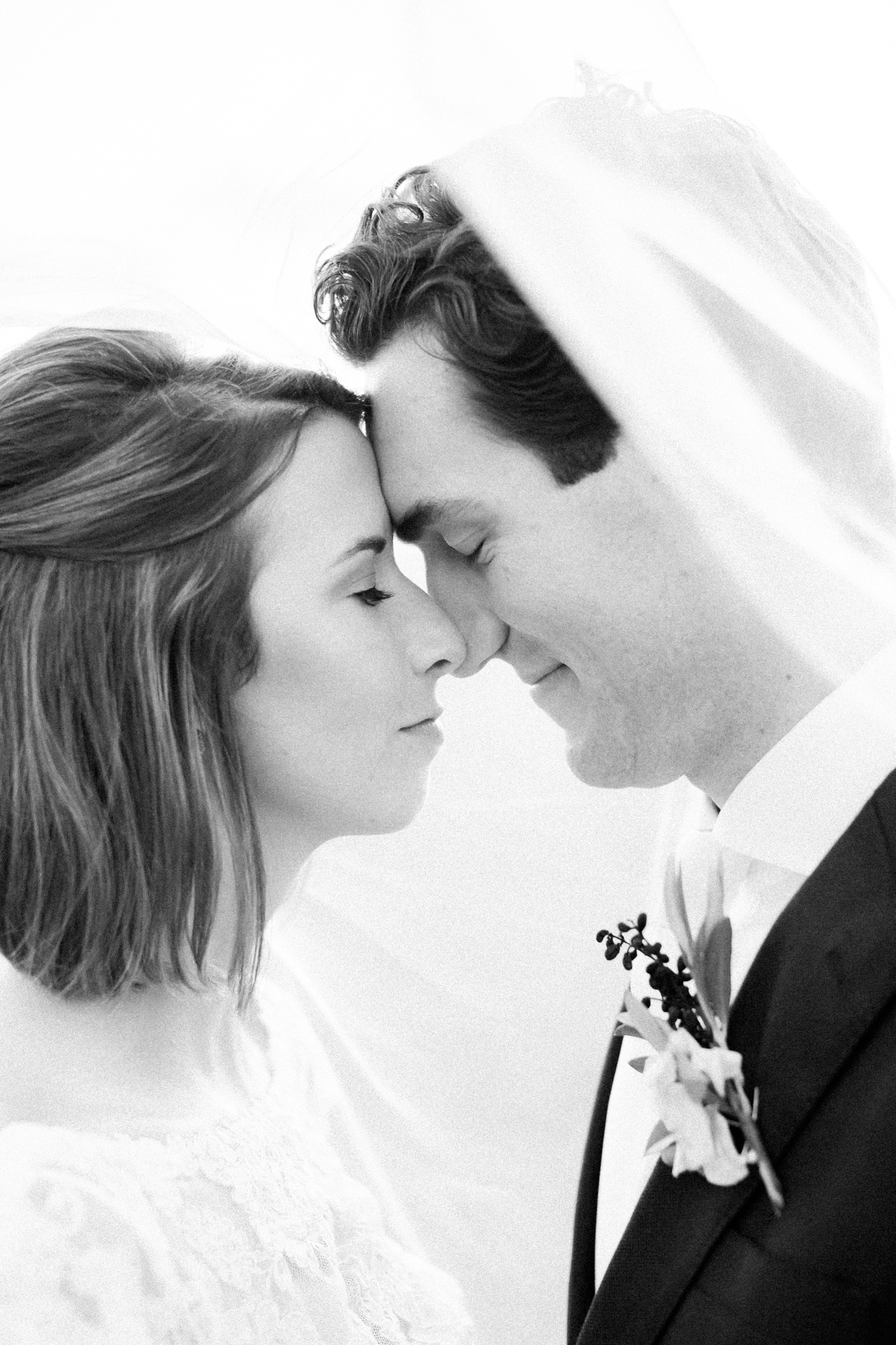 bride and groom closeup in black and white