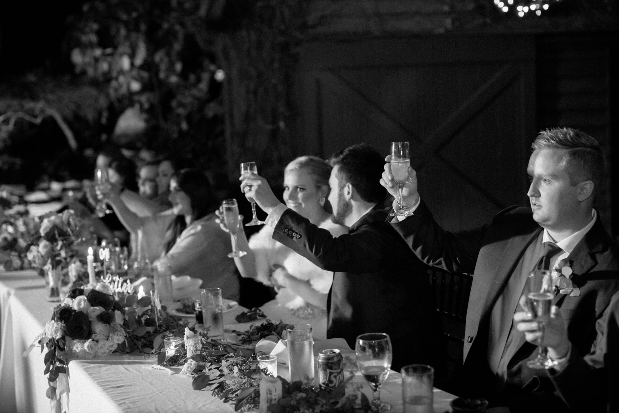 bride and groom toast in black and white