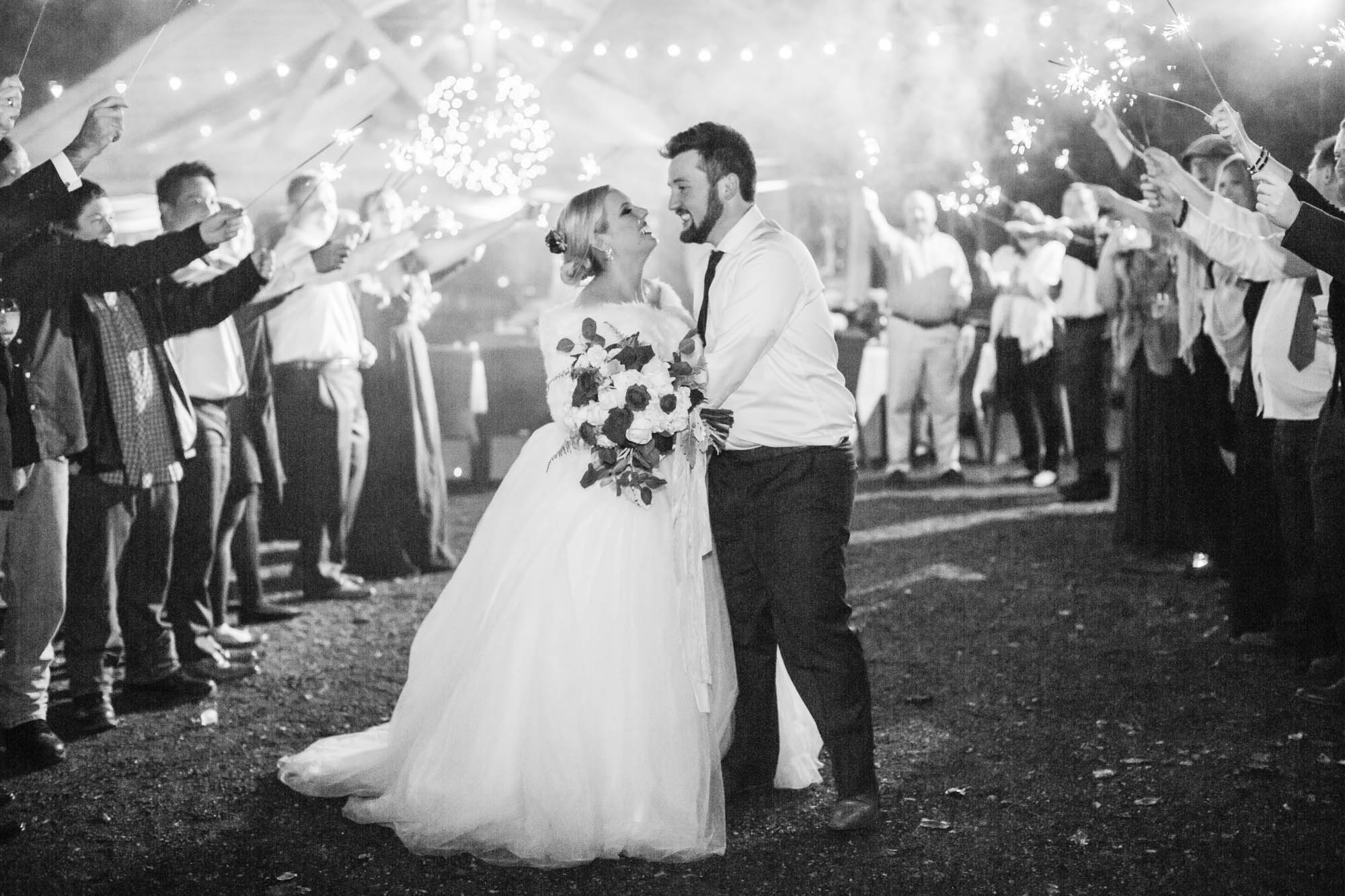 mountain wedding exit with sparklers in black and white