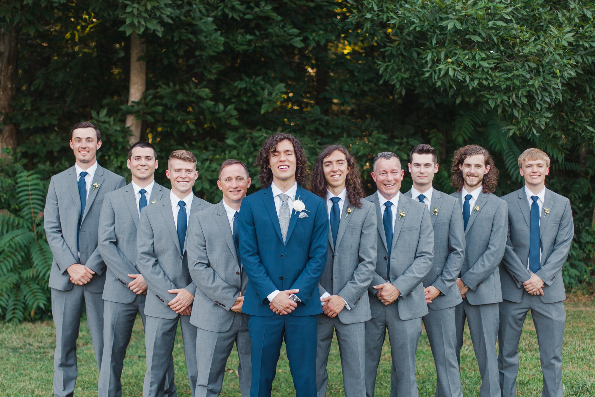 groom with groomsmen different color suits