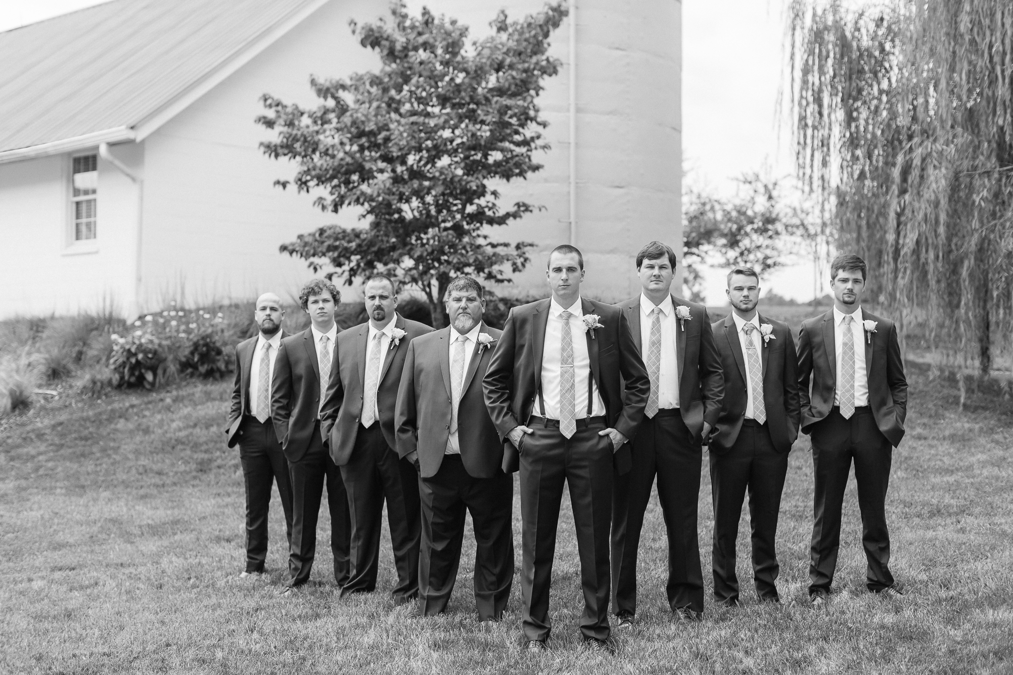 groomsmen flying v pose