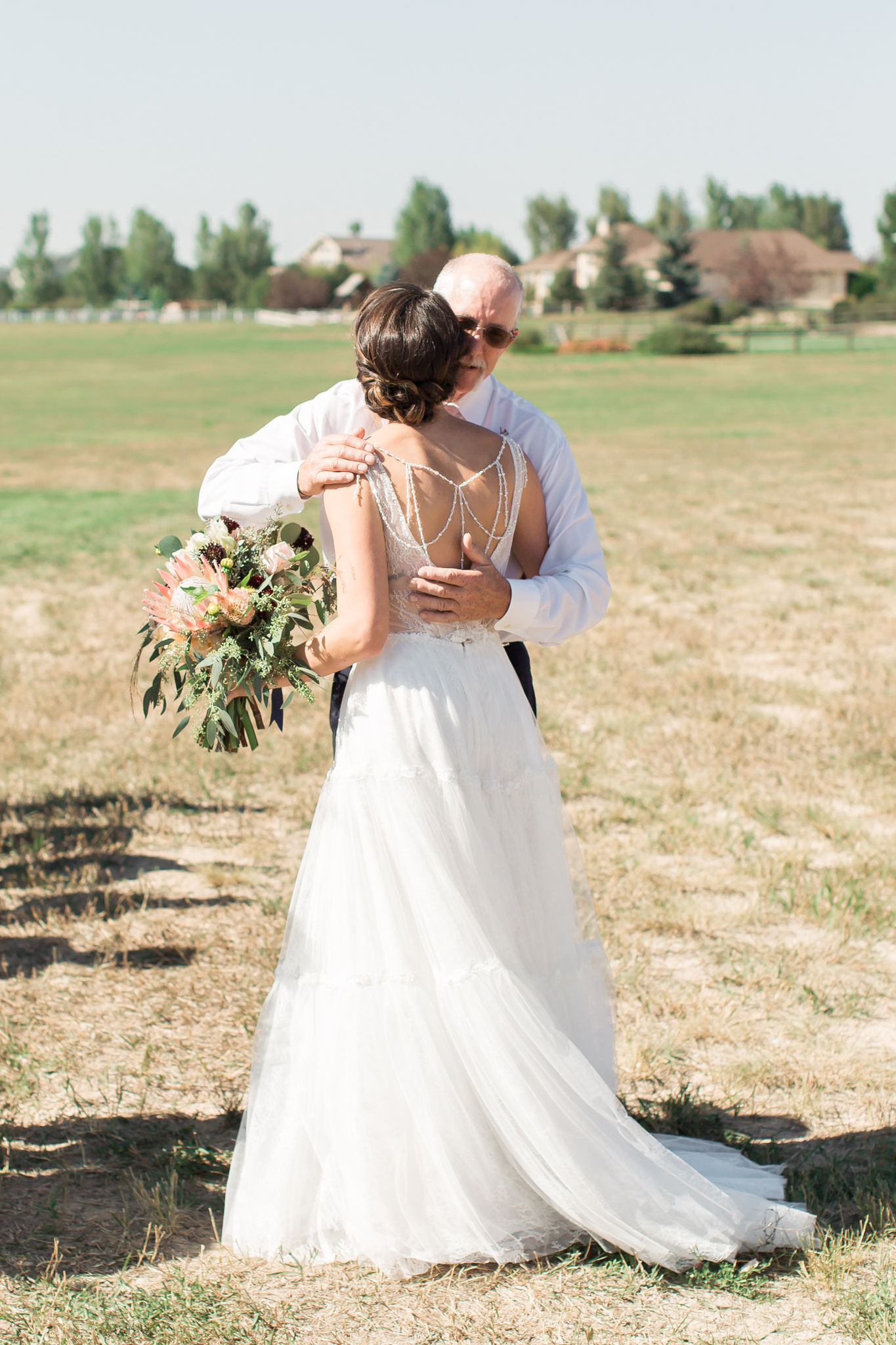 father giving bride away