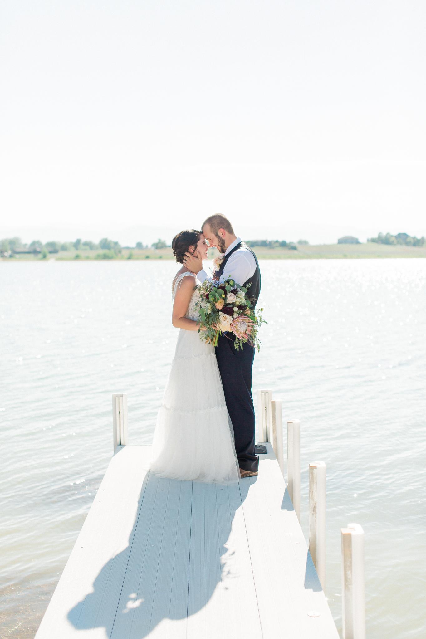 bride and groom on water colorado