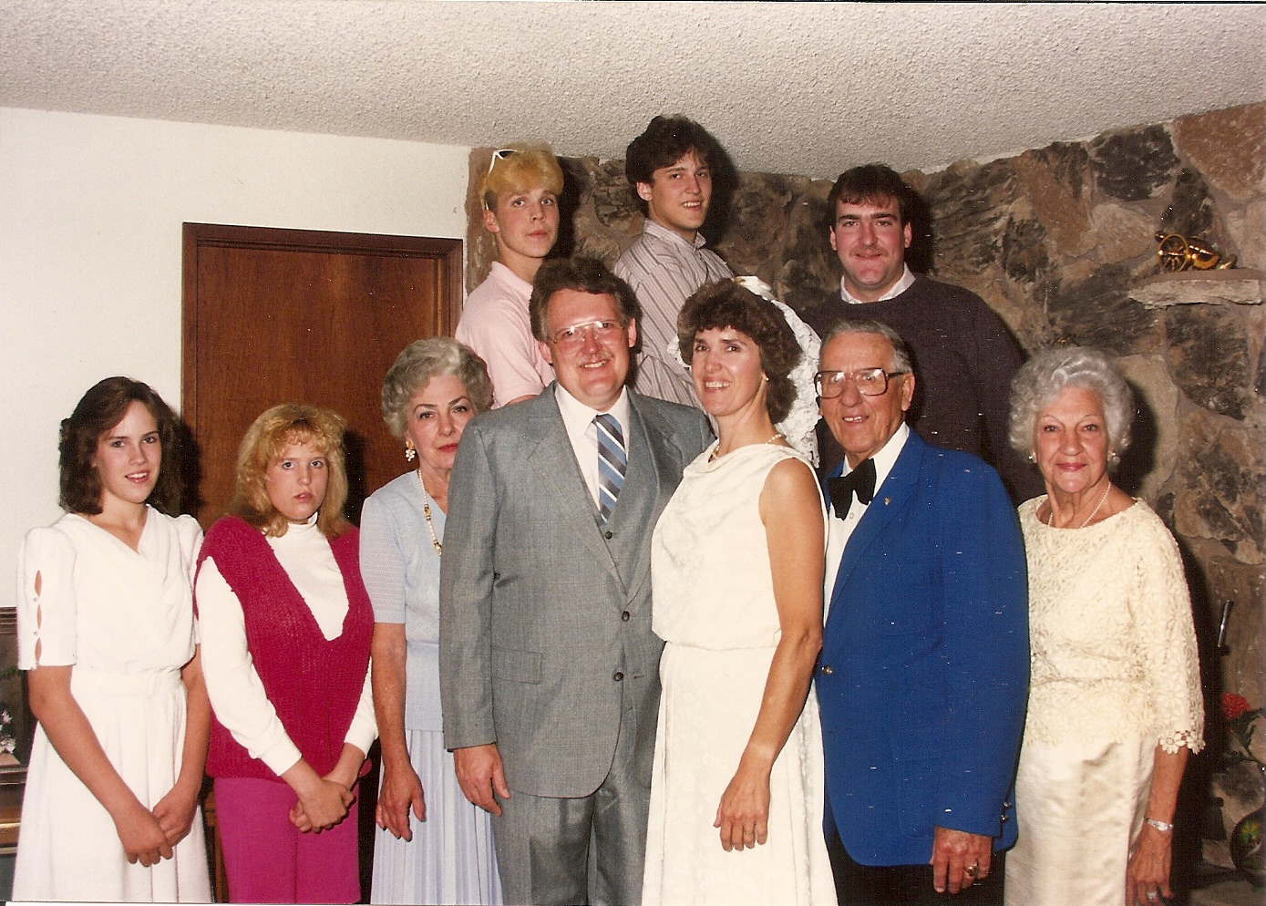 Front row: Mom on the left of the happy couple. My dad Wallace and Grandma Dorothy on the right.