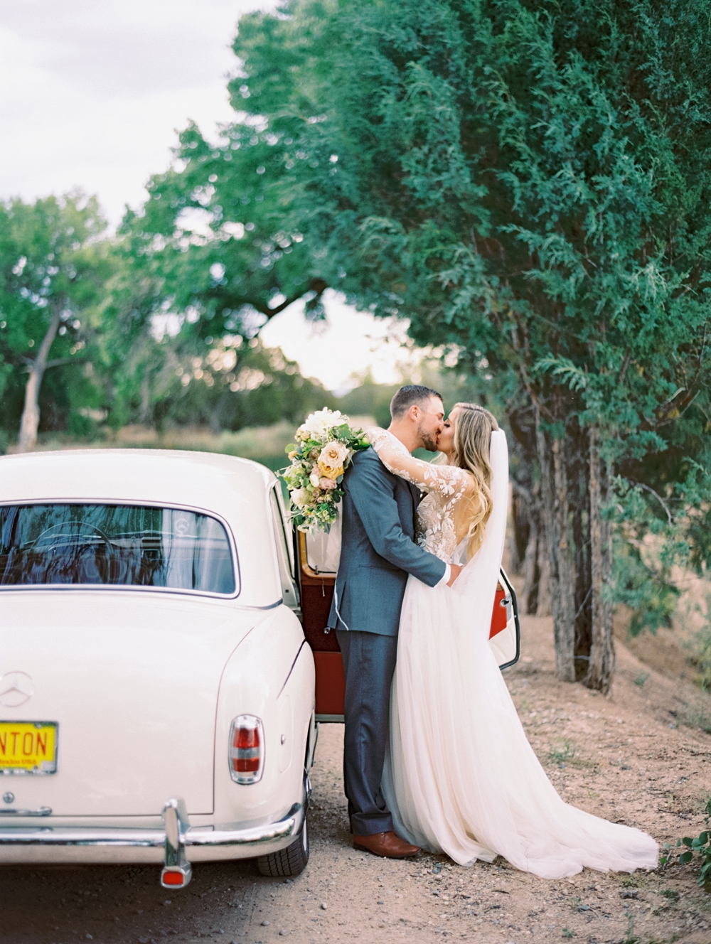 Jacie & Brycen - La Mesita Ranch Wedding   Santa Fe, NMVendors: Ceremony & Reception Venue: La Mesita Ranch Estate    Wedding Planner: For the Love Events   Bride's Wedding Dress: Hayley Paige, purchased at Anna Bé   Shoes: Betsey Johnson   Bridesmaids' Dresses: Adrianna Papell; Amsale; Jenny Yoo; Joanna August   Groom's & Groomsmen's Attire: The Black Tux   Flowers: Floriography Flowers   Invitations & Paper Goods: Olive Branch & Co.  Additional Paper Products: Pennysmith's; Ashley Rose Hamilton   Cake: Miel Bakery   Rentals: Classic Party Rentals; For the Love EventsFeature on BRIDES