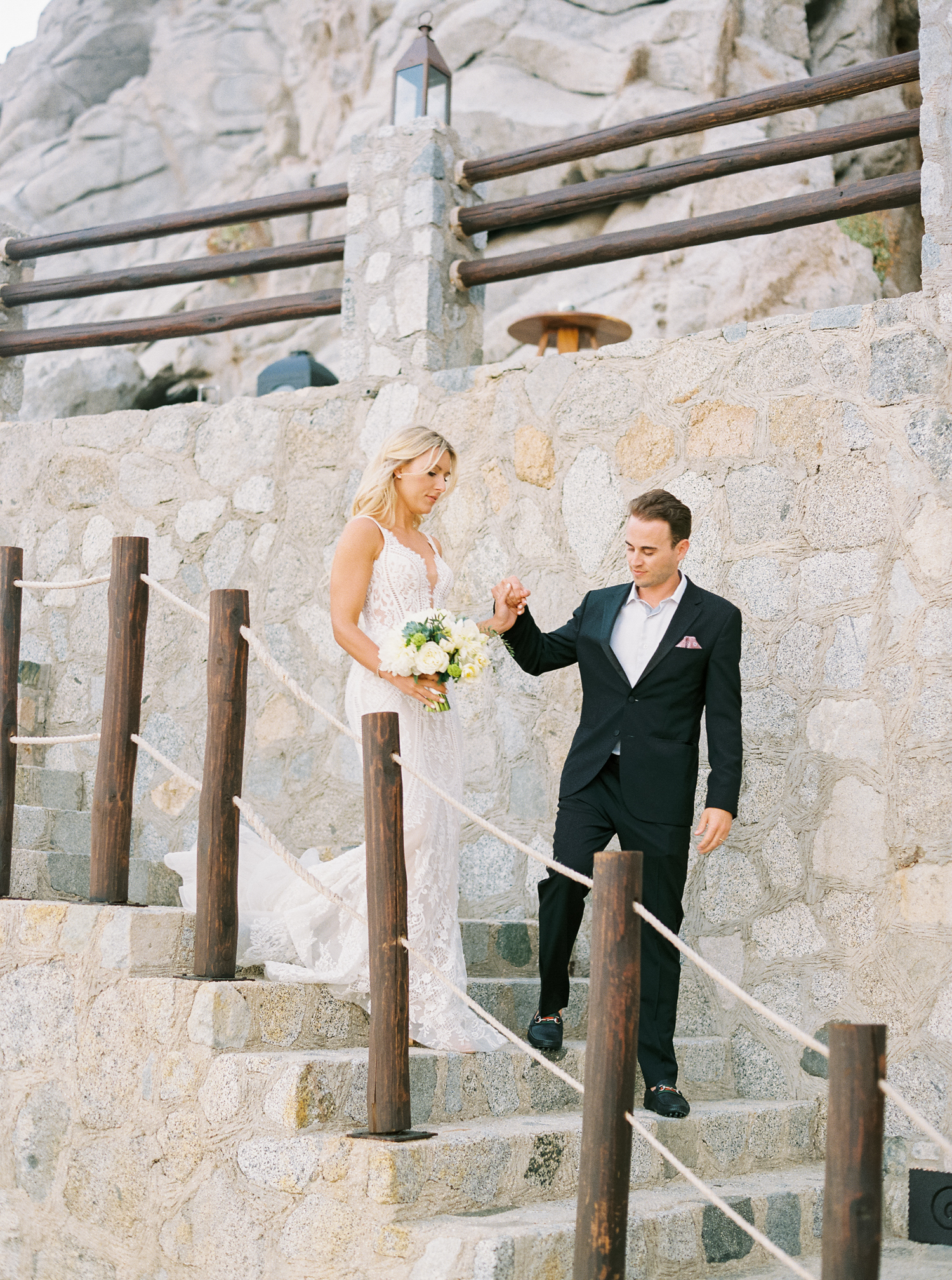 Brittany & Kenny - Resort at Pedregal   Cabo San Lucas, MexicoVendors: Ceremony & Reception: Resort at Pedregal   Planning & Florals: Elena Damy   Bride's Dress: Pallas Couture   Hair & Makeup: Alma Vellejo of Cabo MakeupFeatured on Carats & Cake