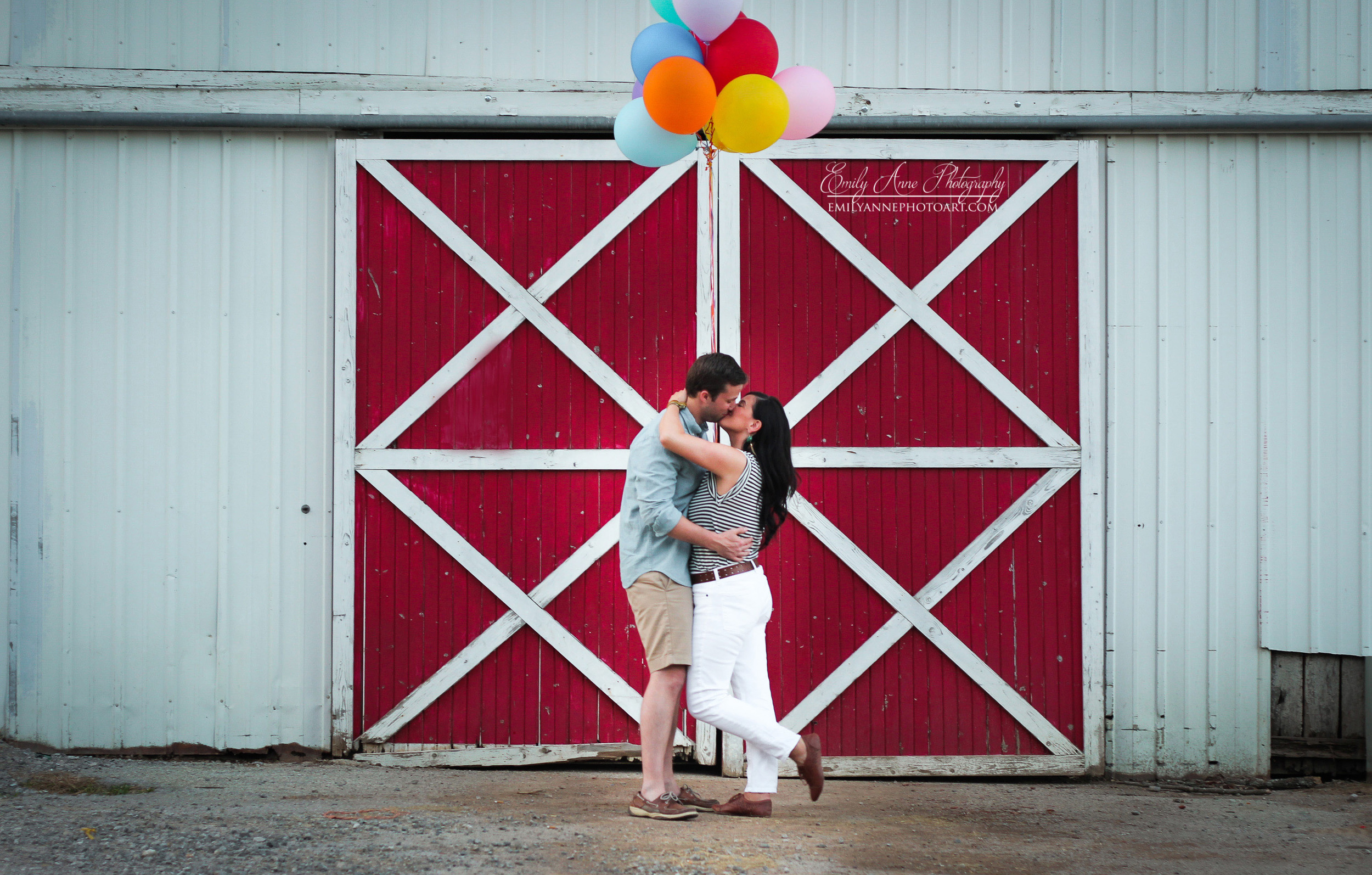 The balloons, the symmetry of the barn, this beautiful couple... I love this shot!