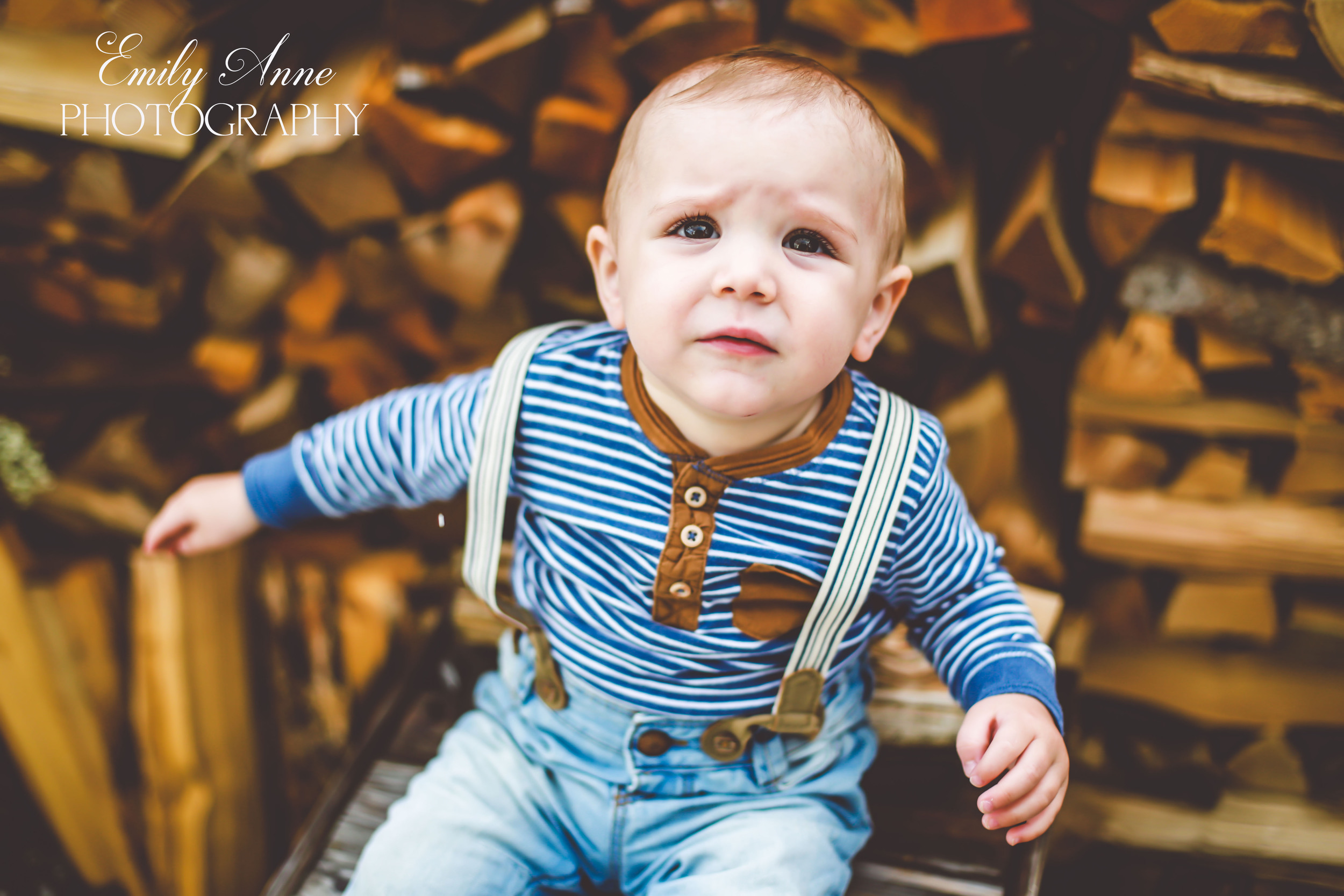 nashville tennessee child photographer middle tennessee Franklin family photos harlinsdale pinkerton affordable nashville family photographer; baby smiles in a woodpile, posing tips and techniques for toddler photography  lifestyle baby photography emily annephotoart nashville and switzerland