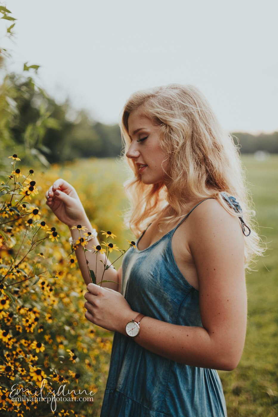 Top go to senior portrait photographer in Nashville, Atlanta, and Brentwood and Franklin TN gorgeous sunny senior portraits with girl out in a field picking flowers; inspirational shots