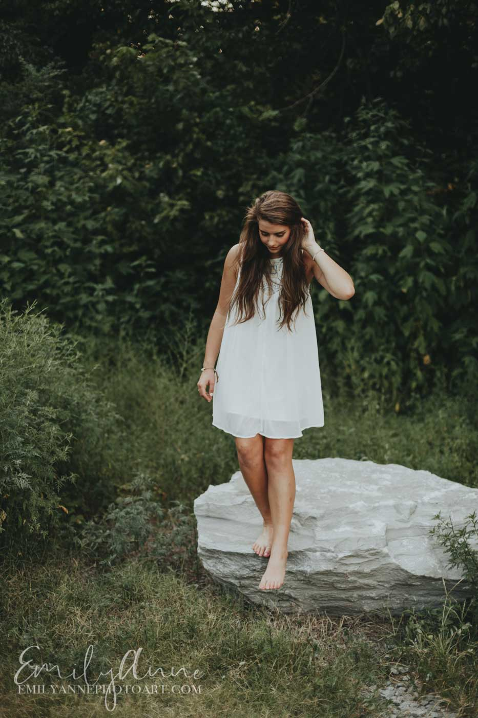 stepping off a rock at Pinkerton park; girl senior portraits all dressed in white Franklin Emily Anne photo art (photography)