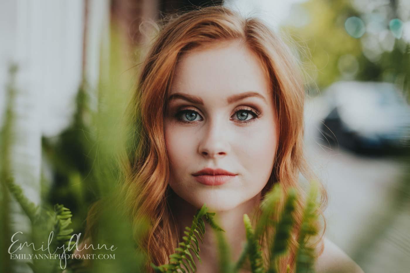 most unique senior portrait ideas shot through ferns and grass in downtown Franklin