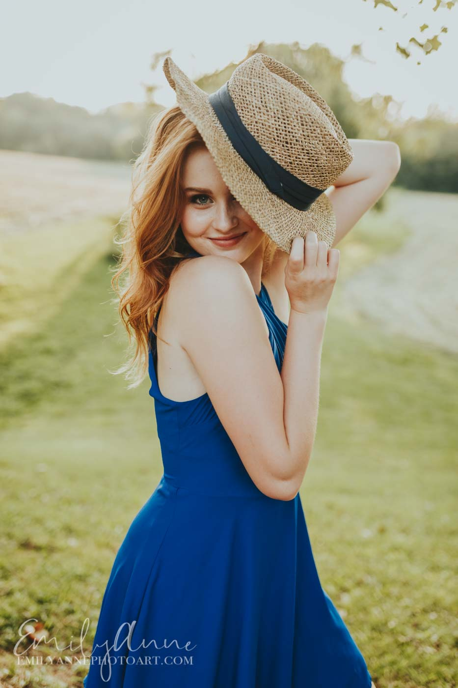 cute senior pics by Emily Anne Photo Art girl in golden field with cute hat!
