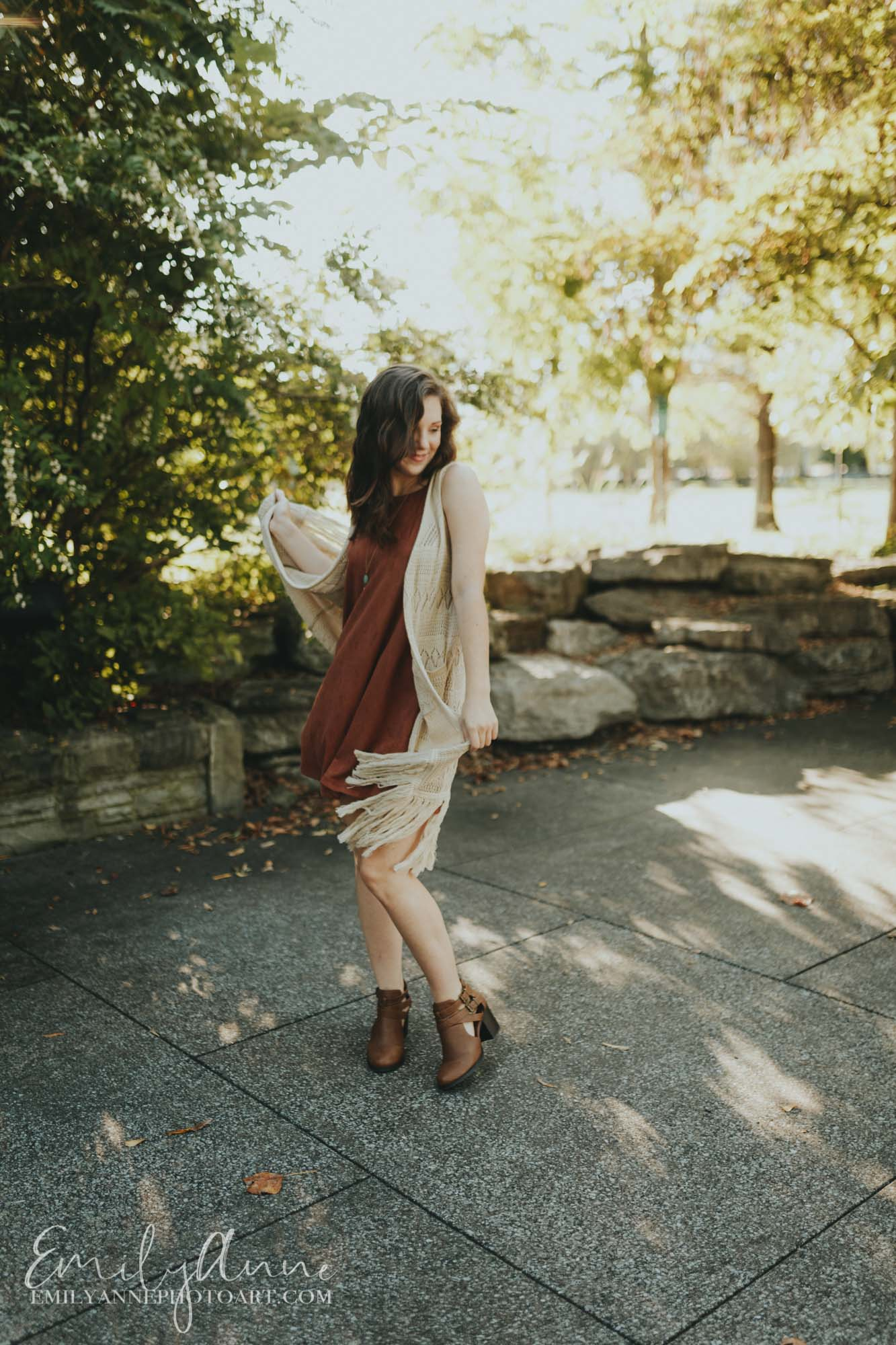 dancing candids for senior portraits at Bicentennial Park Nashville