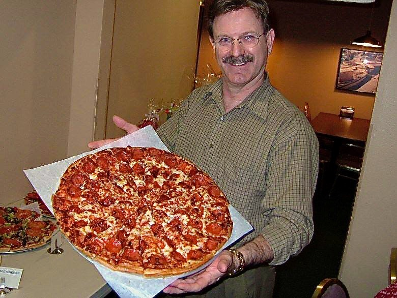 Owner, Jim Gillihan, with a Family size Pepperoni Pizza.