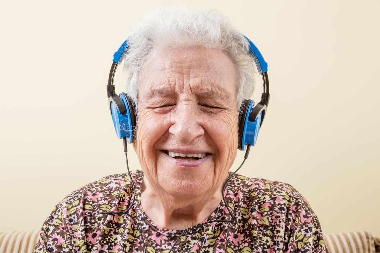 Grandma laughing while listening to music! bella magazine