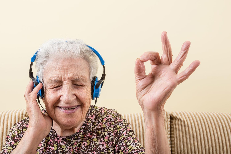 Grandma loving the tunes she is listening too with her massive blue headphones! bella magazine