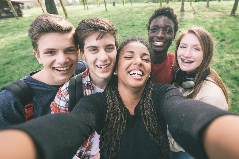Group of school friends taking a selfie. bella magazine
