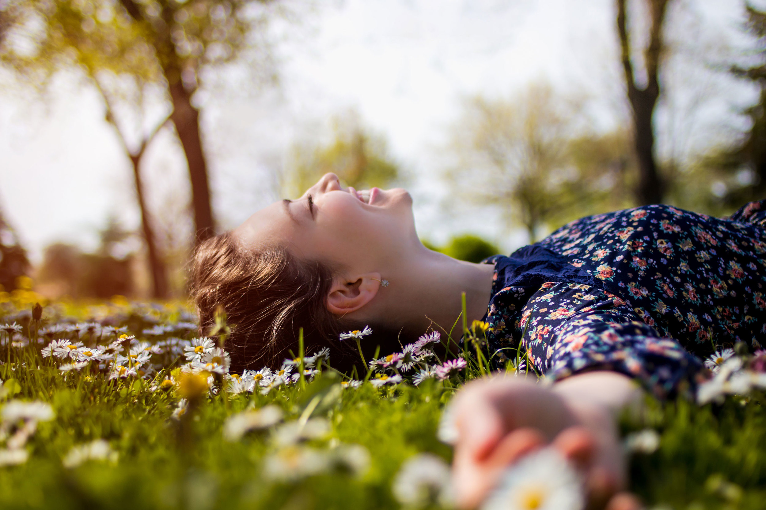 Girl smiling and lying in the grass