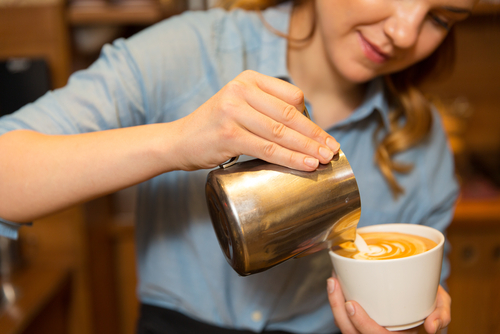 Young woman has first job learning advice on how to be a barista.