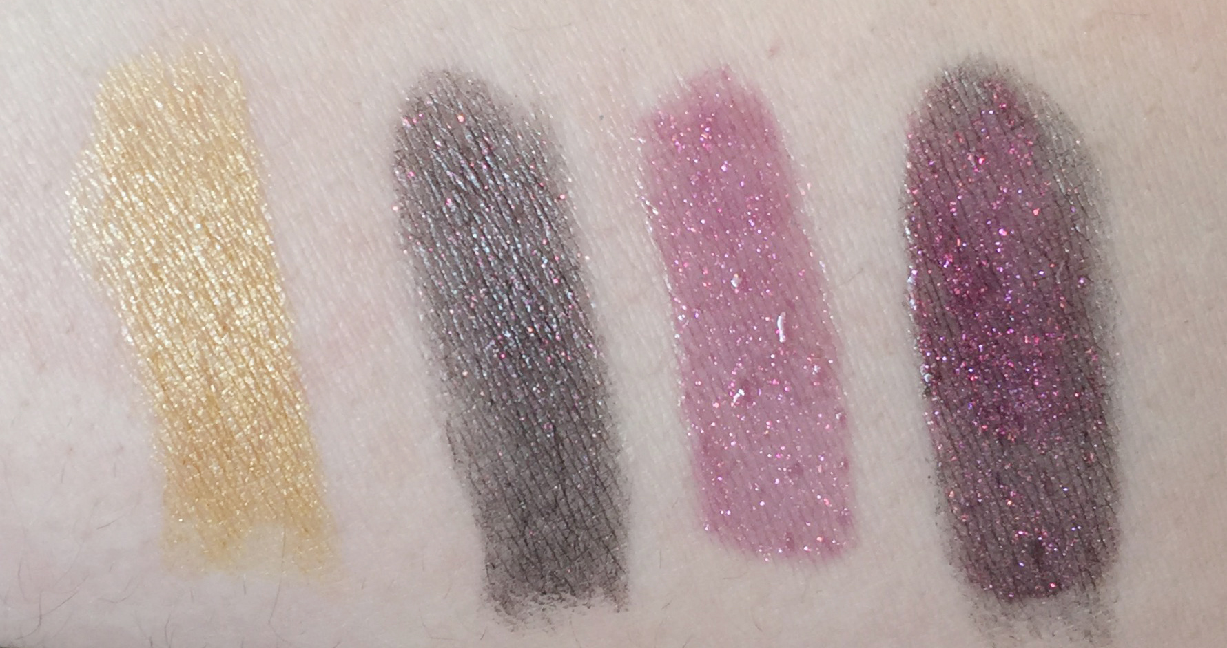 (L-R)M.A.C x Star Trek Lipsticks in the shades 'The Enemy Within' + 'Kling-It-On'and Lip Glass in 'Khaaannn!' The last swatch is a combination of 'Kling-It-On' lipstick and 'Khaaannn!' Lip Glass - shot in natural light