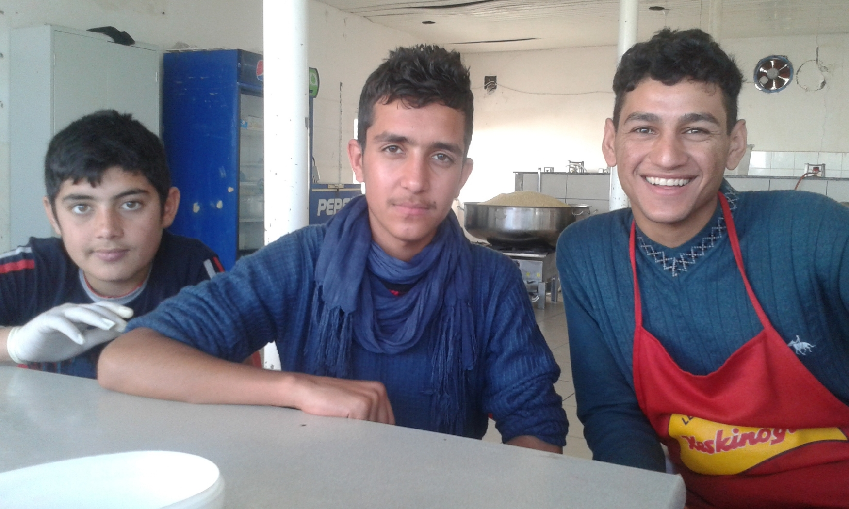 Kurdish Refugee Teens Helping Out in the Kitchen