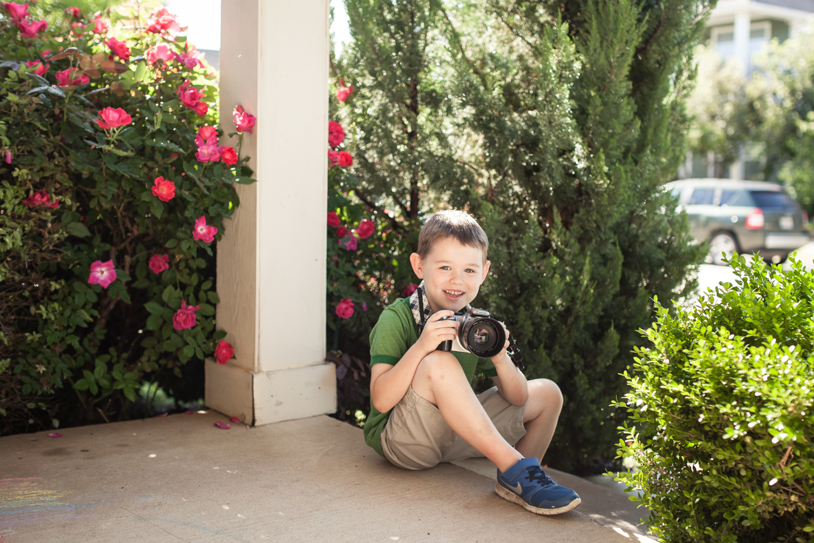 Sam Straka, age 6, practicing his photography on the front patio.