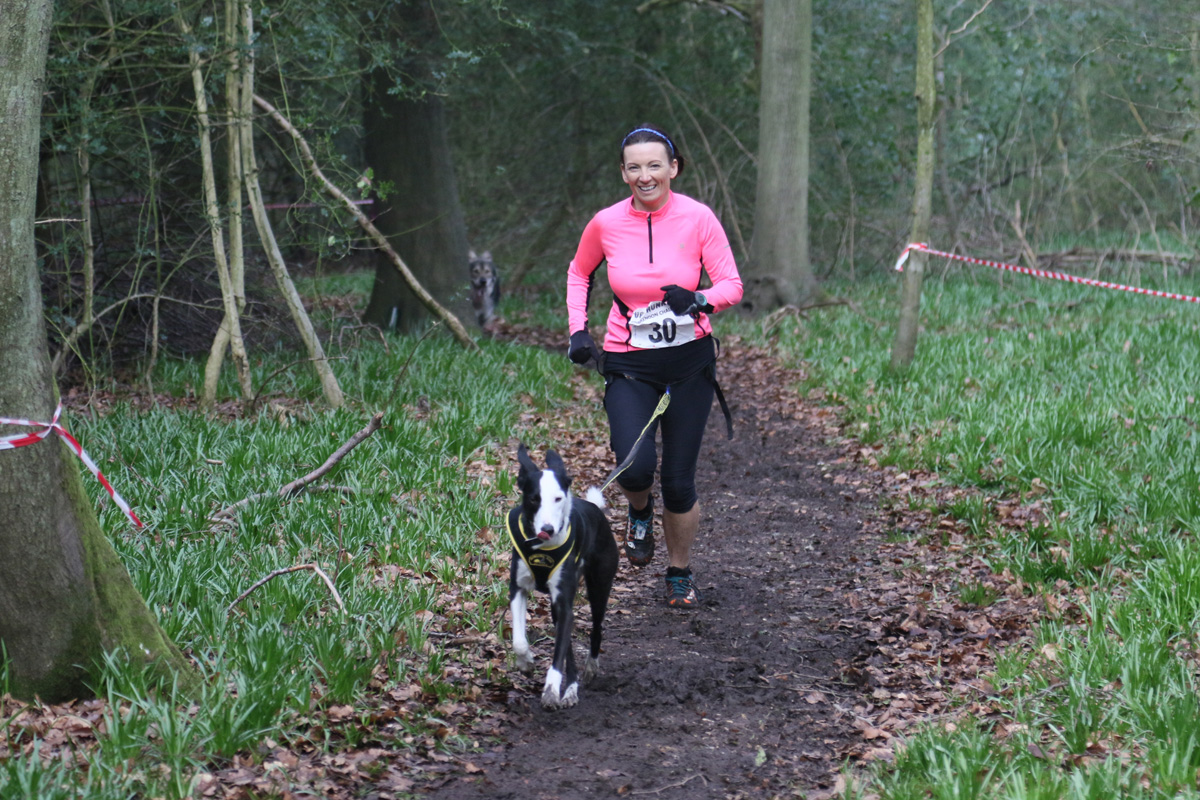 Cate running with Flynn in the Canine Cross