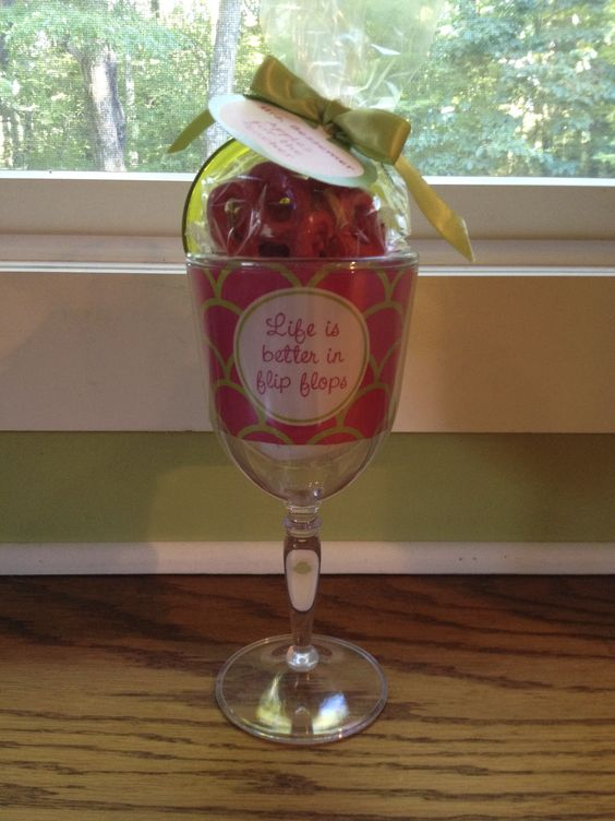 """(PURCHASED) """"LIFE IS BETTER IN FLIP FLOPS"""" PLASTIC WINE GLASS, FILLED WITH """"APPLE"""" PRETZELS"""