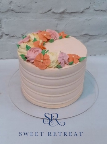 Buttercream flower and swirl cake.jpg