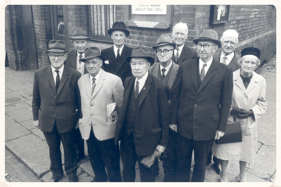 Survivors of the 1st Battalion together again outside Father Matthew Hall in 1964.  L-R; Tom Sheerin, Frank Shouldice, Maurice Collins, Eamon Morkan (b ack row), John S. O'Connor, Mark Flanagan, Piaras Béaslaí, Jack Shouldice, Fionan Lynch, Phyllis Morkan.