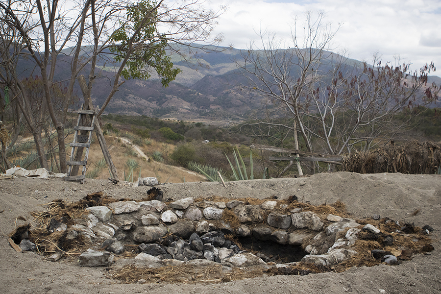 The in ground oven used to smoke the agave