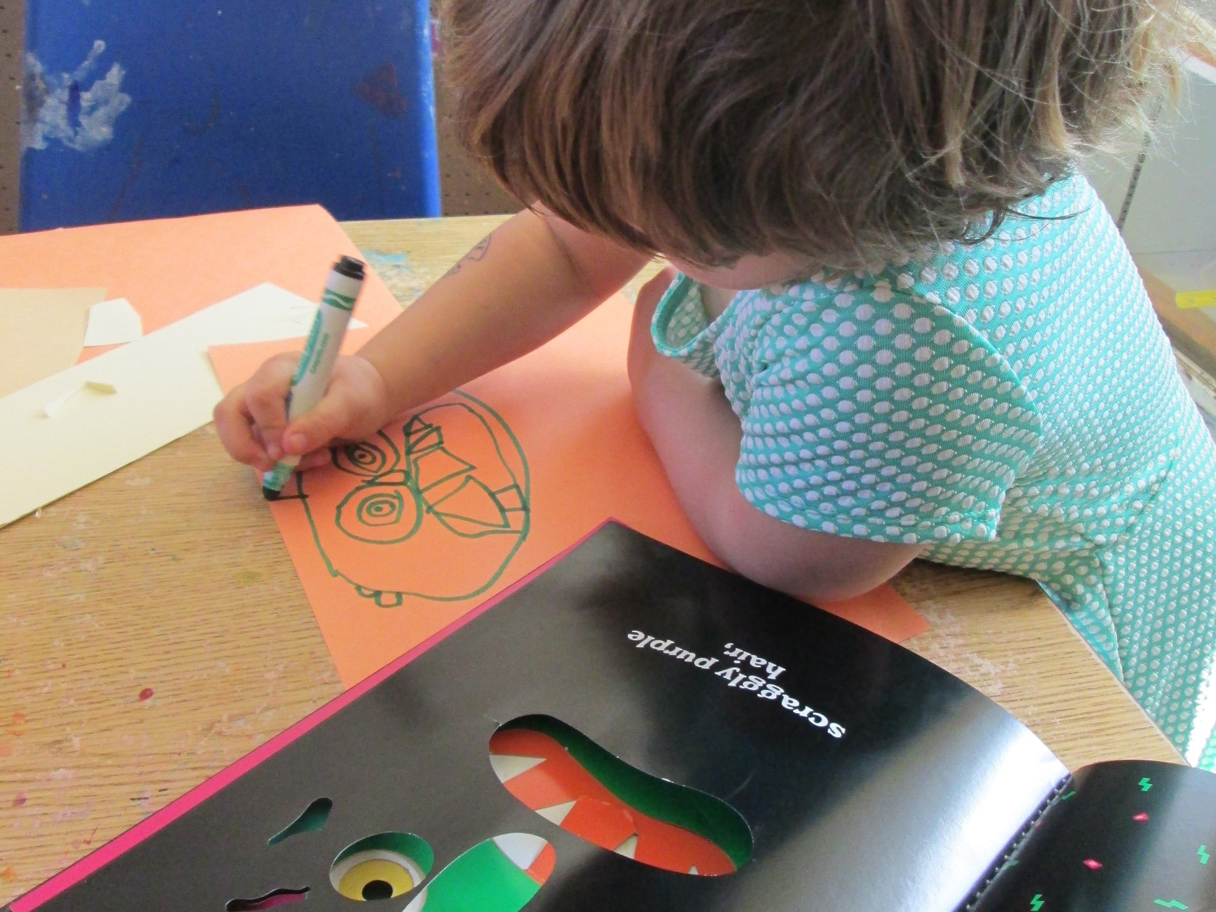 The kids worked with great care and attention as they referenced the book and tried to draw their own monsters.