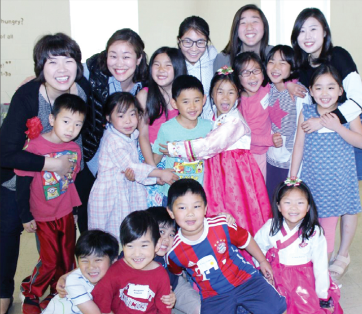 Smiling children and teachers at Korean Culture School
