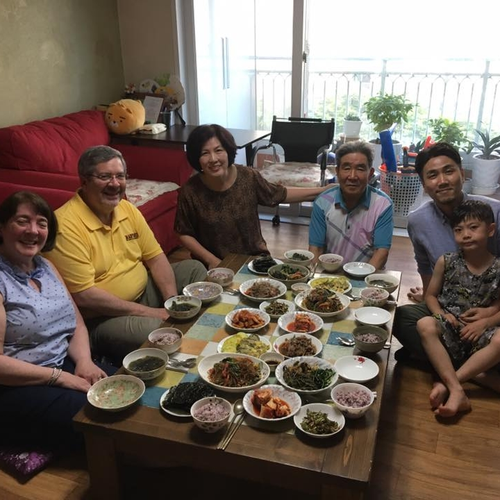 Enjoying a delicious Korean Meal with a host family