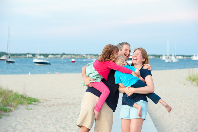 Candid family moment at their 2nd annual beach portrait session.