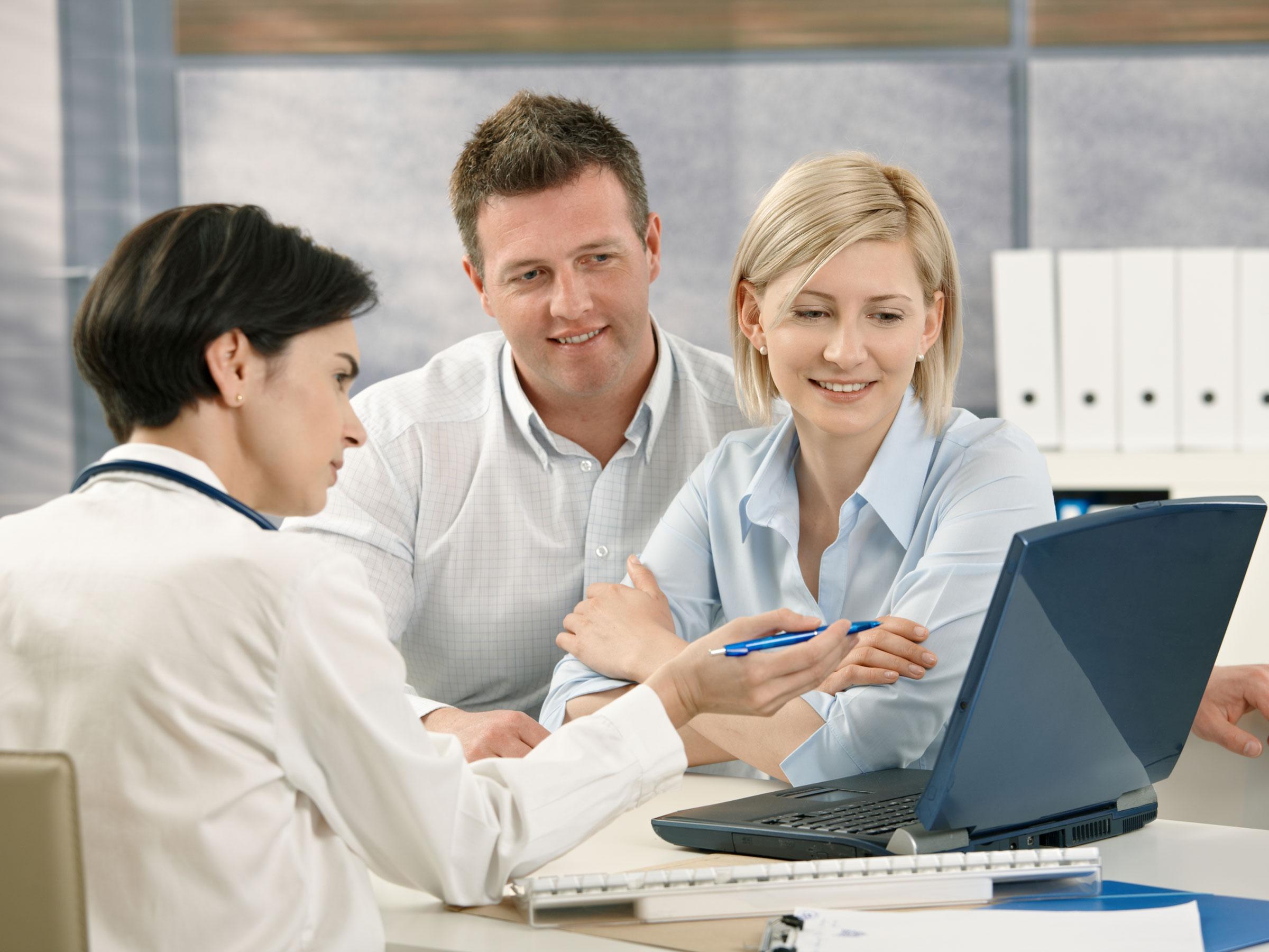doc-with-patients-laptop-.jpg