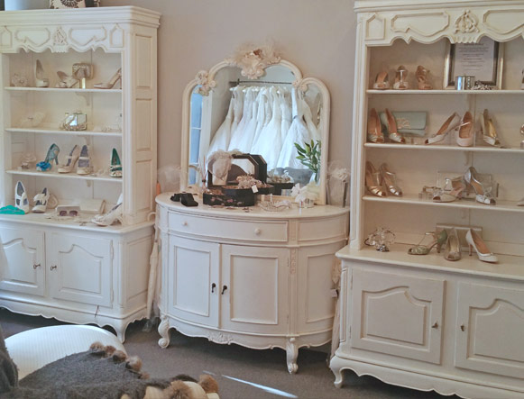 Our front room has a selection of jewellery and headpieces scattered throughout glass cabinets and a large shoe display. An elegant chaise long in the middle of the room is perfect to wait on if you arrive early to your appointment, or to rest while trying on shoes.